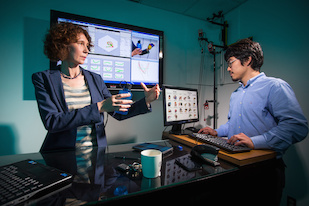 University of Maryland researcher Cornelia Fermüller (left) works with graduate student Yezhou Yang (right) on computer vision systems able to accurately identify and replicate intricate hand movements. Photo: John T. Consoli (Click image to download hi-res version.)