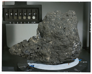 The UMD team examined the tungsten isotopic composition of two moon rocks collected by the Apollo 16 mission, including sample 68815, seen here. When corrected for meteoritic additions to Earth and the moon after formation of the moon, the two bodies were found to have identical Tungsten isotopic compositions. Photo: NASA/JSC (Click image to download hi-res version.)