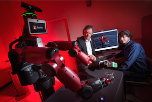 University of Maryland computer scientist Yiannis Aloimonos (center) is developing robotic systems able to visually recognize objects and generate new behavior based on those observations. Photo: John T. Consoli (Click image to download hi-res version.)