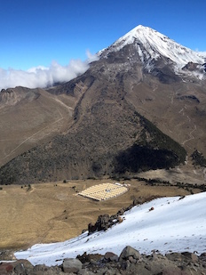 This view of the HAWC observatory was taken from the slopes of Volcán Sierra Negra. Its neighbor, Pico de Orizaba, is the highest peak in Mexico and is visible in the background. Photo: HAWC Collaboration (Click image to download hi-res version.)