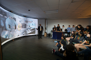 Amitabh Varshney, a professor of computer science at UMD, director of the University of Maryland Institute for Advanced Computer Studies, and director of the Virtual and Augmented Reality Laboratory, explains the applications of virtual and augmented reality to Computer Science Connect students in the Augmentarium. Credit: John T. Consoli (Click image to download hi-res version.)
